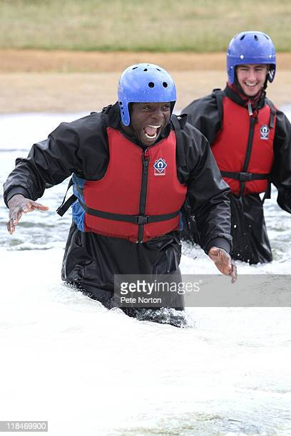 Adebayo Akinfenwa of Northampton Town walks through a whirlpool during a training session at Nene Whitewater Centre on July 7, 2011 in Northampton,...