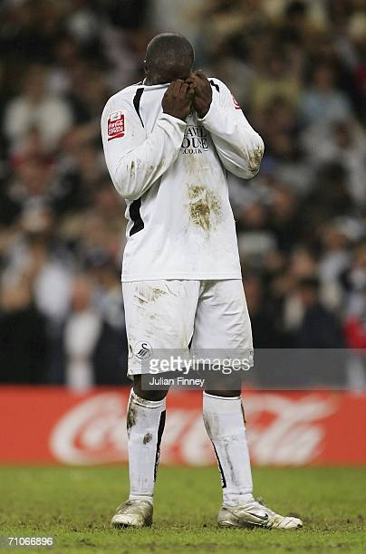 Adebayo Akinfenwa of Swansea City looks dejected after missing a penalty in the end of match shoot out during the League One Playoff Final match...