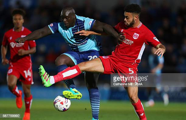 Adebayo Akinfenwa of Wycombe Wanderers and Derrick Williams of Bristol City during the EFL Cup match between Wycombe Wanderers and Bristol City at...