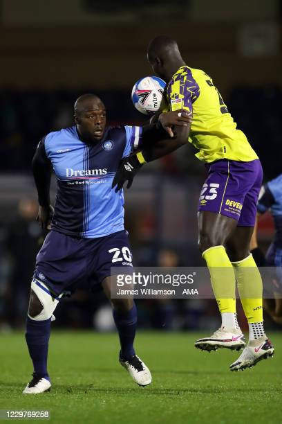 Adebayo Akinfenwa of Wycombe Wanderers and Naby Sarr of Huddersfield Town during the Sky Bet Championship match between Wycombe Wanderers and...