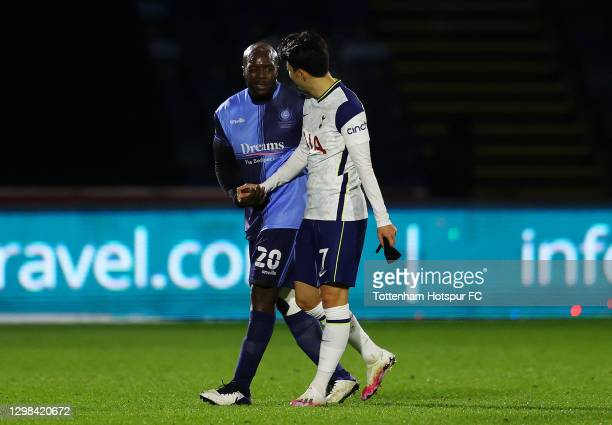 Adebayo Akinfenwa of Wycombe Wanderers and Son Heung-Min of Tottenham Hotspur interact during The Emirates FA Cup Fourth Round match between Wycombe...