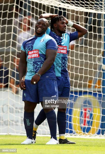 Adebayo Akinfenwa of Wycombe Wanderers and teammate react after a missed opportunity during the preseason friendly match between Wycombe Wanderers...