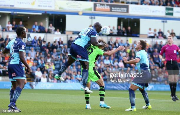 Adebayo Akinfenwa of Wycombe Wanderers battles for the ball with Christian Doidge of Forest Green Rovers during the Sky Bet League Two match between...