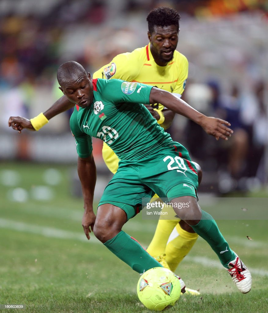 Adebayor Emmanuel Sheyi of Togo tries to tackle Sanou Wilfried Leon Bakary of Burkina Faso during the 2013 Africa Cup of Nations Quarter-Final match between Burkina Faso and Togo at the Mbombela Stadium on February 3, 2013 in Nelspruit, South Africa.