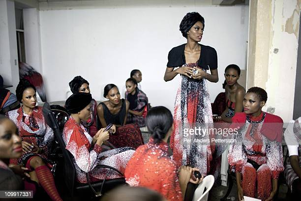 Adebisi Sowemimo a Nigerian Model stands among other models before a show with the designer David Tlale at his studios at the Joburg Fashion Week on...