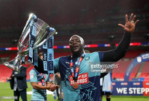 Adedbayo Akinfenwa of Wycombe Wanderers celebrates with the trophy after the Sky Bet League One Play Off Final between Oxford United and Wycombe...
