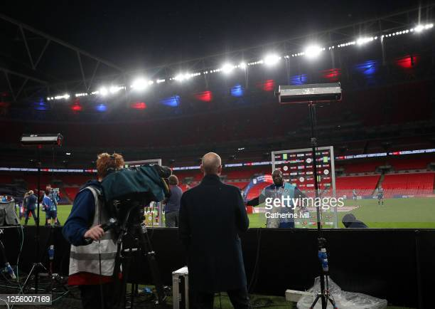Adedbayo Akinfenwa of Wycombe Wanderers takes part in a socially distanced television interview after the Sky Bet League One Play Off Final between...