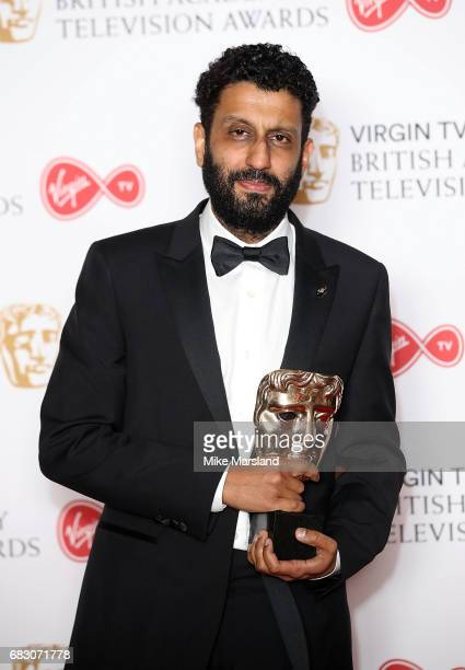 Adeel Akhtar winner of the Leading Actor award for 'Murdered By My Father' poses in the Winner's room at the Virgin TV BAFTA Television Awards at The...