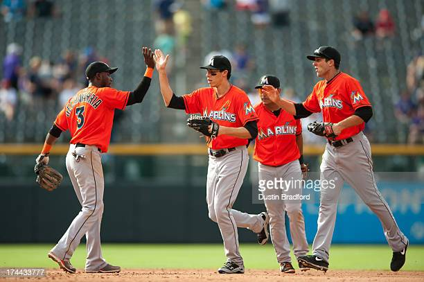 Adeiny Hechavarria Donovan Solano Christian Yelich and Jake Marisnick of the Miami Marlins run off the field and celebrate after beating the Colorado...