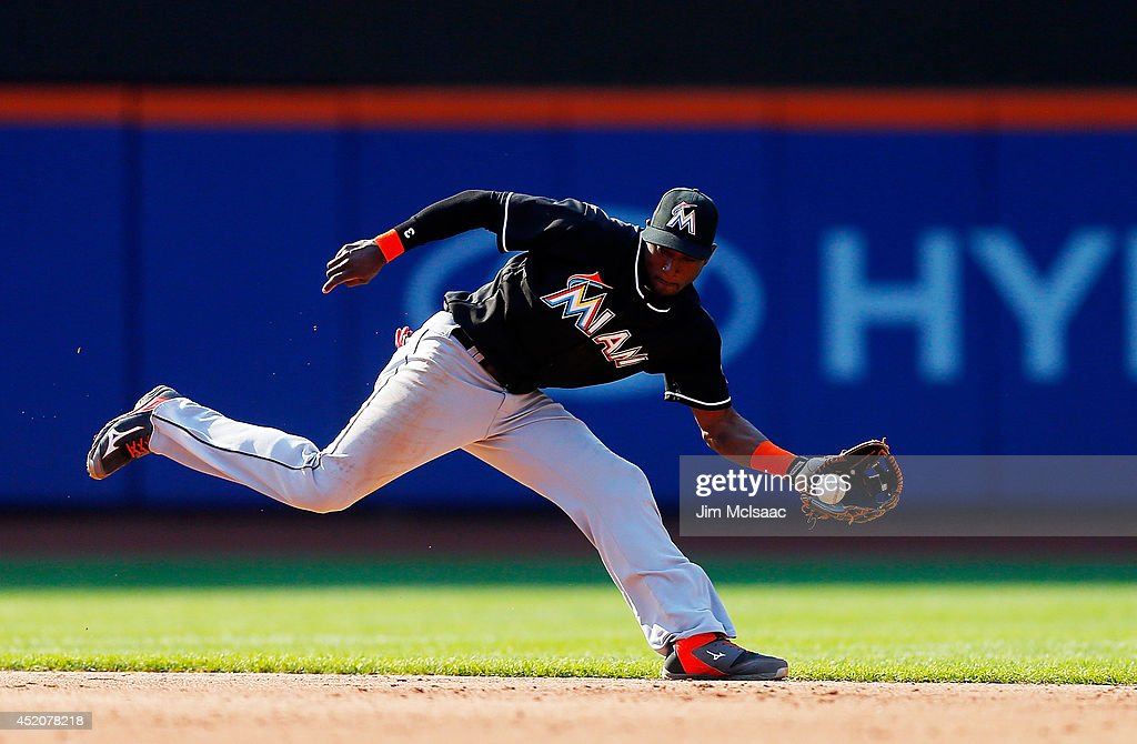 Adeiny Hechavarria #3 of the Miami Marlins fields the ball for an out in the third inning against Juan Lagares of the New York Mets at Citi Field on July 12, 2014 in the Flushing neighborhood of the Queens borough of New York City.