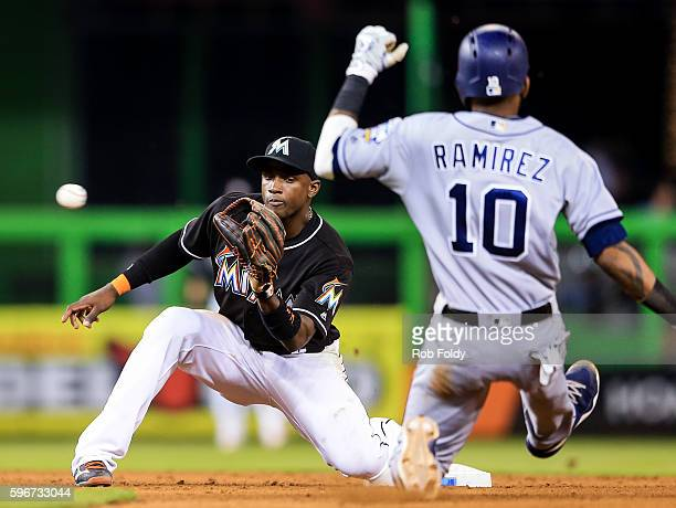 Adeiny Hechavarria of the Miami Marlins in action before tagging out Alexei Ramirez of the San Diego Padres attempting to steal second base during...