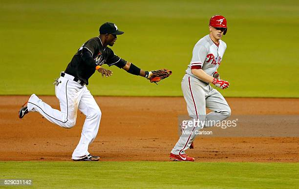 Adeiny Hechavarria of the Miami Marlins tags out Jeremy Hellickson of the Philadelphia Phillies in a rundown during the third inning of a game at...