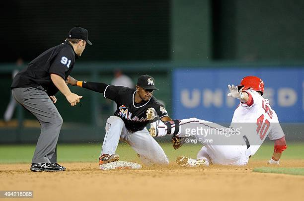 Adeiny Hechavarria of the Miami Marlins tags out Wilson Ramos of the Washington Nationals in the ninth inning at Nationals Park on May 28 2014 in...