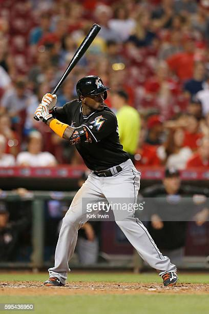 Adeiny Hechavarria of the Miami Marlins takes an at bat during the game against the Cincinnati Reds at Great American Ball Park on August 18 2016 in...