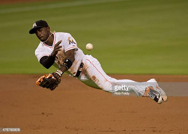 Adeiny Hechavarria of the Miami Marlins throws to first base during the third inning of the game against the Colorado Rockies at Marlins Park on June...