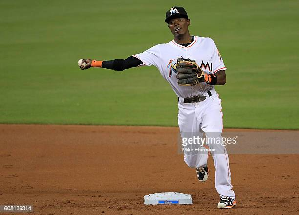 Adeiny Hechavarria of the Miami Marlins turns a double play during a game against the Washington Nationals at Marlins Park on September 19 2016 in...