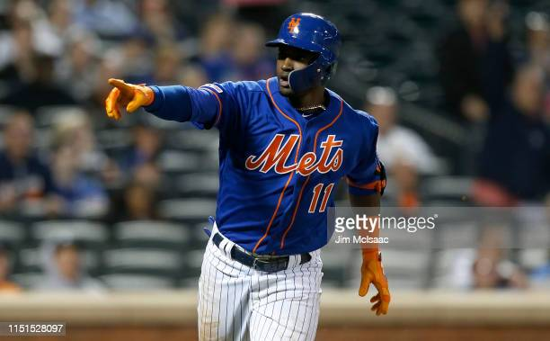 Adeiny Hechavarria of the New York Mets reacts towards the dugout after his fourth inning three run home run against the Detroit Tigers at Citi Field...