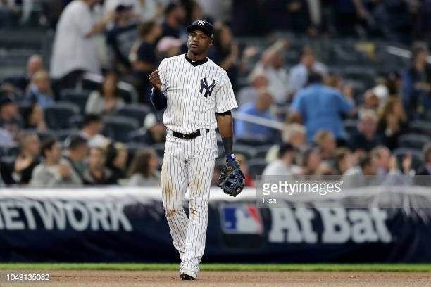 Adeiny Hechavarria of the New York Yankees celebrates after making an out against the Oakland Athletics during the seventh inning in the American...