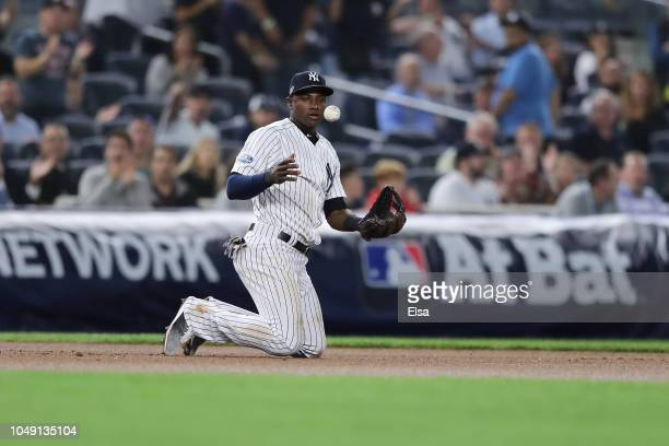 Adeiny Hechavarria of the New York Yankees reacts after making an out against the Oakland Athletics during the seventh inning in the American League...