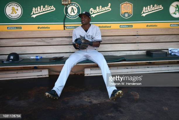 Adeiny Hechavarria of the New York Yankees sits in the dugout and looks on prior to the start of the game against the Oakland Athletics at Oakland...