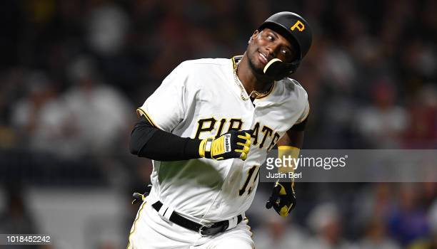Adeiny Hechavarria of the Pittsburgh Pirates reacts after flying out to center field in the fifth inning during the game against the Chicago Cubs at...