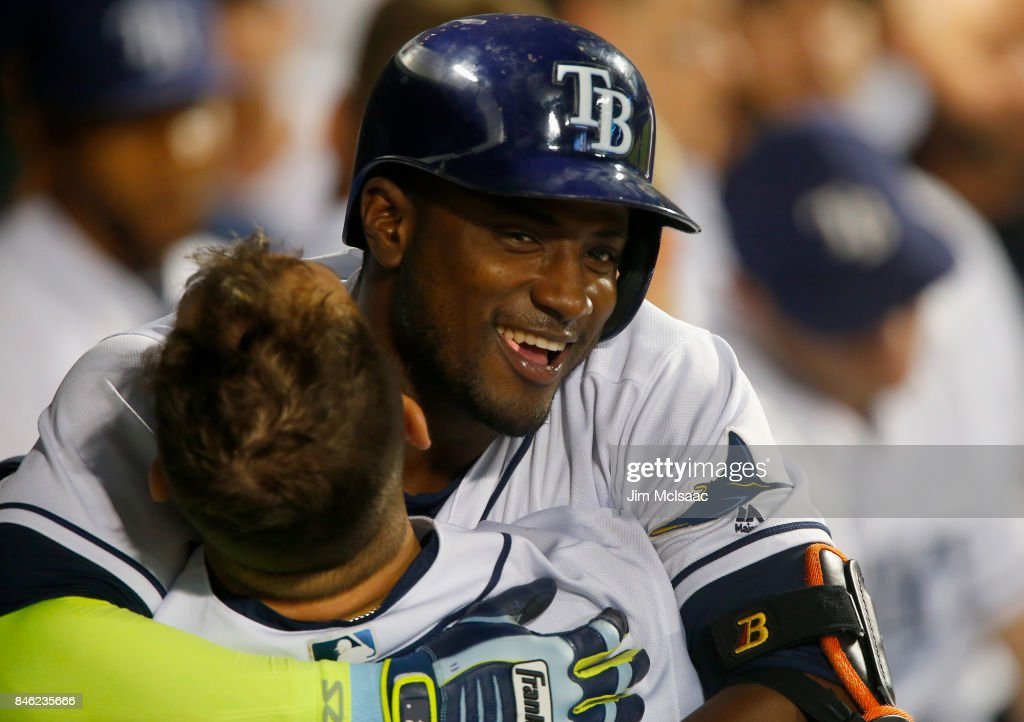 Adeiny Hechavarria #11 of the Tampa Bay Rays celebrates his eighth inning home run against the New York Yankees in the dugout with teammate Steven Souza Jr. #20 at Citi Field on September 12, 2017 in the Flushing neighborhood of the Queens borough of New York City. The two teams were scheduled to play in St. Petersburg, Florida but due to the weather emergency caused by Hurricane Irma, the game was moved to New York, but with Tampa Bay remaining the 'home' team.