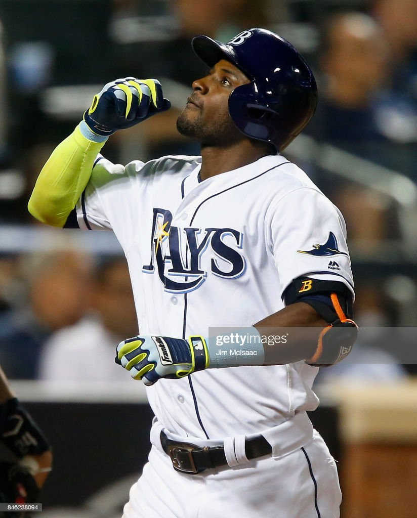 Adeiny Hechavarria #11 of the Tampa Bay Rays celebrates his eighth inning home run against the New York Yankees at Citi Field on September 12, 2017 in the Flushing neighborhood of the Queens borough of New York City. The two teams were scheduled to play in St. Petersburg, Florida but due to the weather emergency caused by Hurricane Irma, the game was moved to New York, but with Tampa Bay remaining the 'home' team.