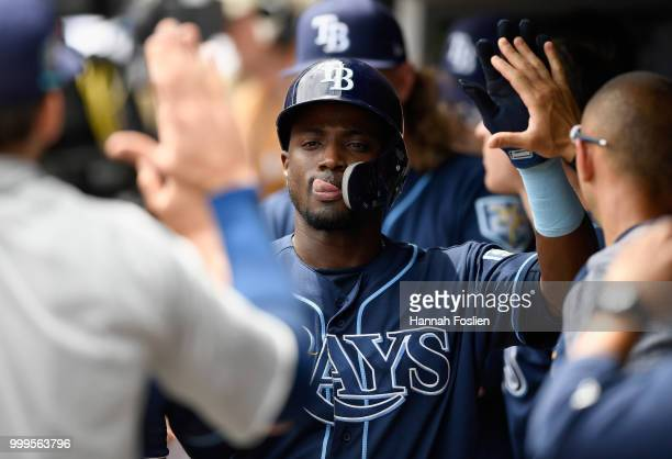 Adeiny Hechavarria of the Tampa Bay Rays celebrates scoring a run against the Minnesota Twins during the second inning of the game on July 15 2018 at...