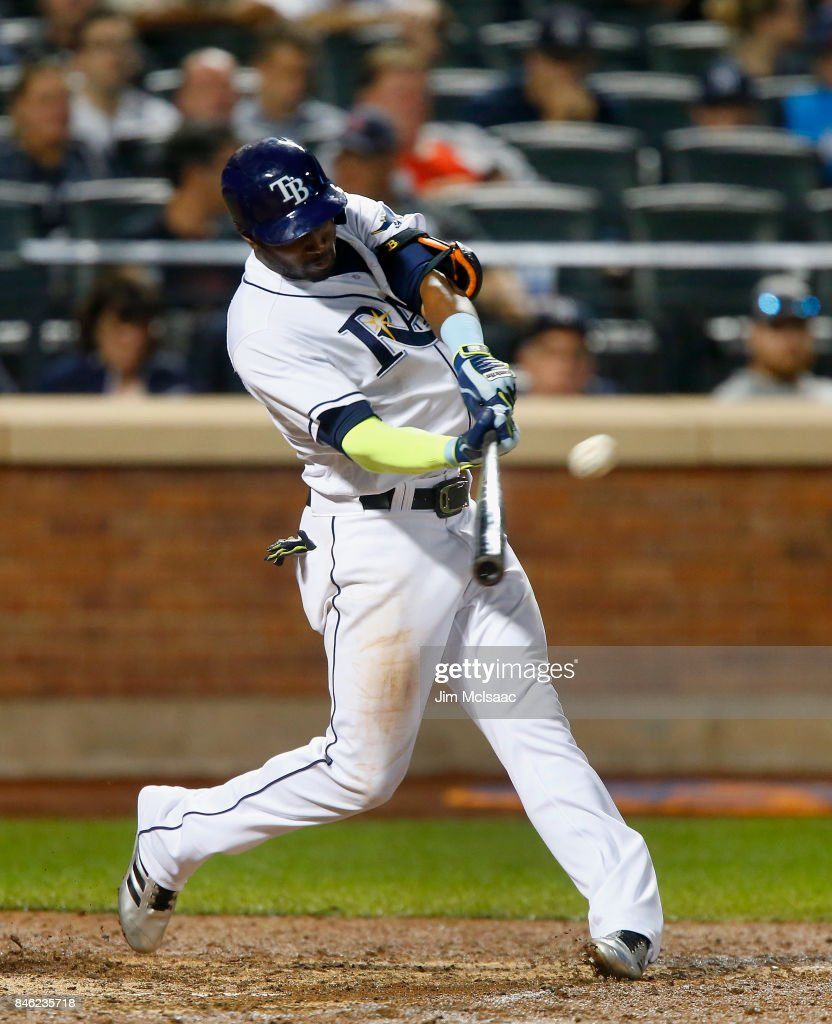 Adeiny Hechavarria #11 of the Tampa Bay Rays connects on an eighth inning home run against the New York Yankees at Citi Field on September 12, 2017 in the Flushing neighborhood of the Queens borough of New York City. The two teams were scheduled to play in St. Petersburg, Florida but due to the weather emergency caused by Hurricane Irma, the game was moved to New York, but with Tampa Bay remaining the 'home' team.