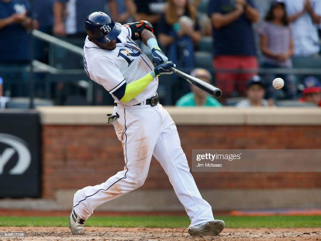 Adeiny Hechavarria #11 of the Tampa Bay Rays connects on an eighth inning RBI single against the New York Yankees at Citi Field on September 13, 2017 in the Flushing neighborhood of the Queens borough of New York City. The two teams were scheduled to play in St. Petersburg, Florida but due to the weather emergency caused by Hurricane Irma, the game was moved to New York, but with Tampa Bay remaining the 'home' team.