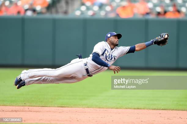 Adeiny Hechavarria of the Tampa Bay Rays dives after a hit by Mark Trumbo of the Baltimore Orioles in the eight inning during a baseball game at...
