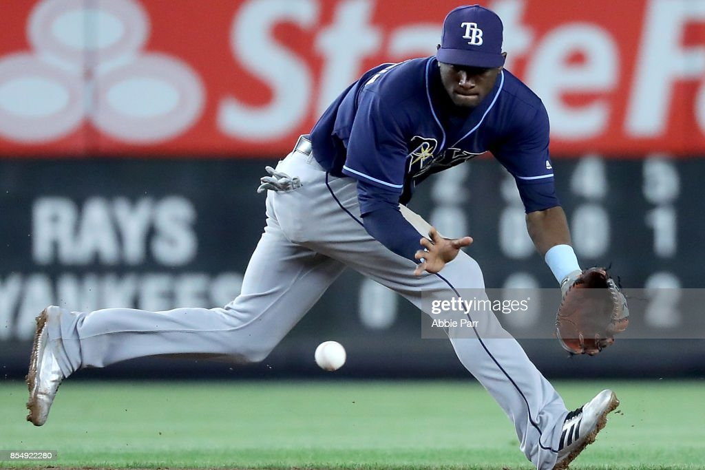 Adeiny Hechavarria #11 of the Tampa Bay Rays fields a ground ball against the New York Yankees in the eighth inning at Yankee Stadium on September 27, 2017 in the Bronx borough of New York City.