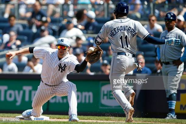 Adeiny Hechavarria of the Tampa Bay Rays is safe on an infield single as Neil Walker of the New York Yankees is unable to handle the throw during the...