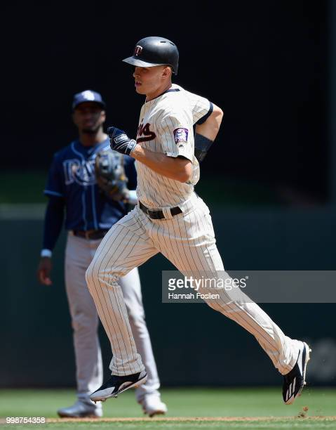Adeiny Hechavarria of the Tampa Bay Rays looks on as Max Kepler of the Minnesota Twins rounds the bases after hitting a solo home run during the...