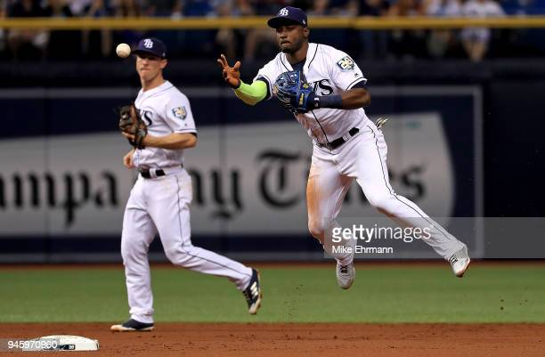 Adeiny Hechavarria of the Tampa Bay Rays makes a throw to first during a game against the Philadelphia Phillies at Tropicana Field on April 13 2018...