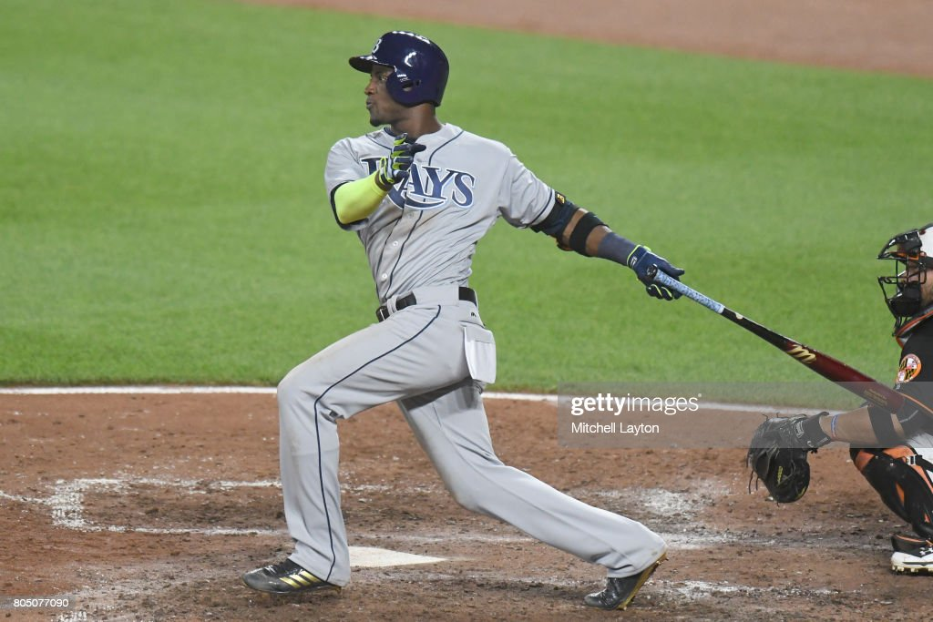 Adeiny Hechavarria #11 of the Tampa Bay Rays singles in Peter Bourjas #18 (not pictured) in the ninth inning during a baseball game against the Baltimore Orioles at Oriole Park at Camden Yards on June 30, 2017 in Baltimore, Maryland. The Rays won 6-4 in ten innings