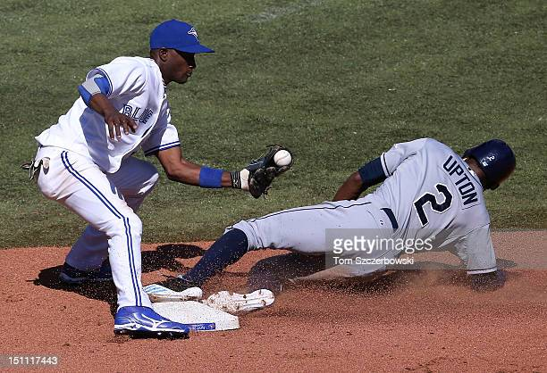 Adeiny Hechavarria of the Toronto Blue Jays applies the tag in the seventh inning during MLB game action as BJ Upton of the Tampa Bay Rays steals...