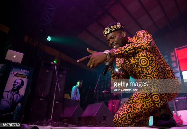"Adekunle Gold and his 79th Element Band perform at the ""Afrika Shrine"" dedicated to the pioneer of Afrobeat, Fela Anikulapo Kuti, during the annual..."