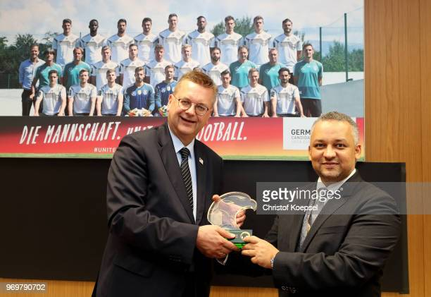 Adel Ezzat president of the Saudi Arabia Football Federation hands out a present to Reinhard Grindel DFB president rprior to the International...