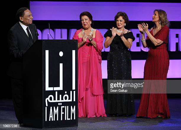 Adel Imam accepts the Lifetime Achievement Award with actresses Raja Al Jiddawi Lubluba and Yosra onstage at the Awards Show and Closing Night Red...