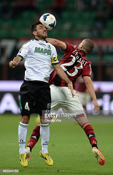 Adel Taarabt of AC Milan and Francesco Magnanelli of US Sassuolo Calcio compete for the ball during the Serie A match between AC Milan and US...
