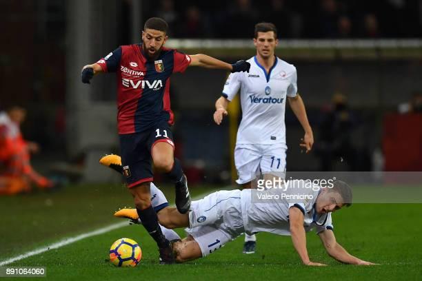 Adel Taarabt of Genoa CFC is challenged by Mattia Caldara of Atalanta BC during the Serie A match between Genoa CFC and Atalanta BC at Stadio Luigi...