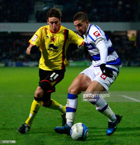 Adel Taarabt of QPR battles for the ball with Will Buckley of Watford during the npower Championship match between Queens Park Rangers and Watford at...