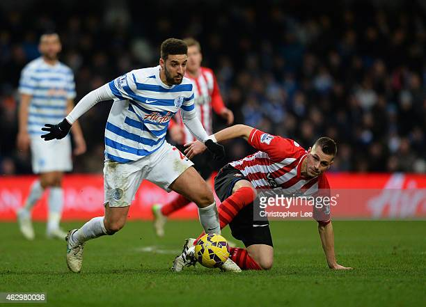 Adel Taarabt of QPR gets away from Morgan Schneiderlin of Southampton during the Barclays Premier League match between Queens Park Rangers and...
