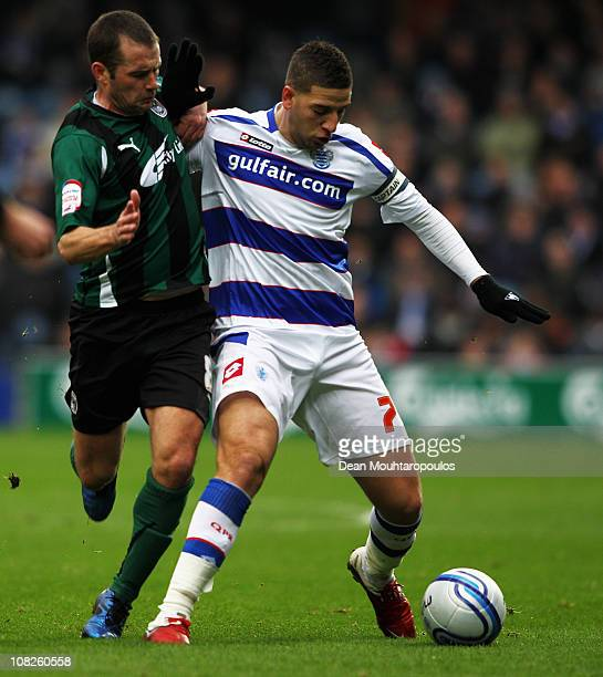 Adel Taarabt of QPR holds off Michael Doyle of Coventry during the npower Championship match between Queens Park Rangers and Coventry City at Loftus...