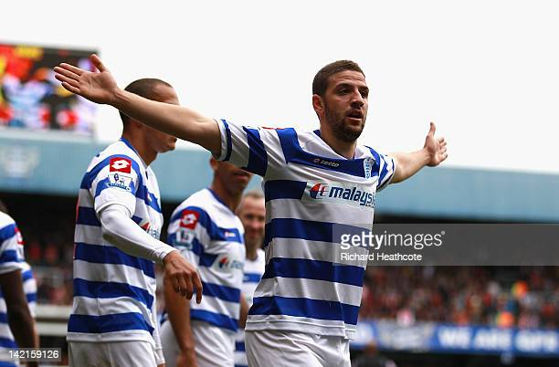 Adel Taarabt of Queens Park Rangers celebrates scoring the opening goal during the Barclays Premier League match between Queens Park Rangers and...
