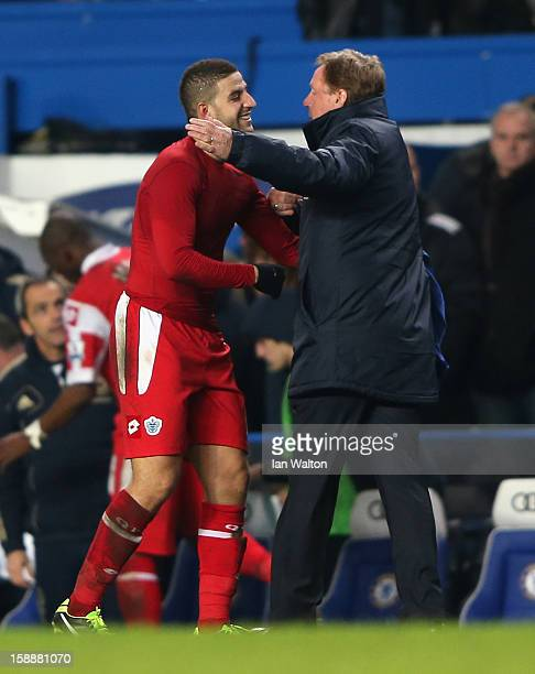Adel Taarabt of Queens Park Rangers celebrates victory with manager Harry Redknapp after the Barclays Premier League match between Chelsea and Queens...