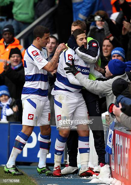 Adel Taarabt of Queens Park Rangers is congratulated by his team mates after scoring the fourth goal during the npower Championship match between...