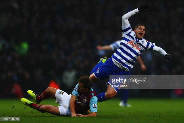 Adel Taarabt of Queens Park Rangers is tackled by Mark Noble of West Ham United during the Barclays Premier League match between West Ham United and...