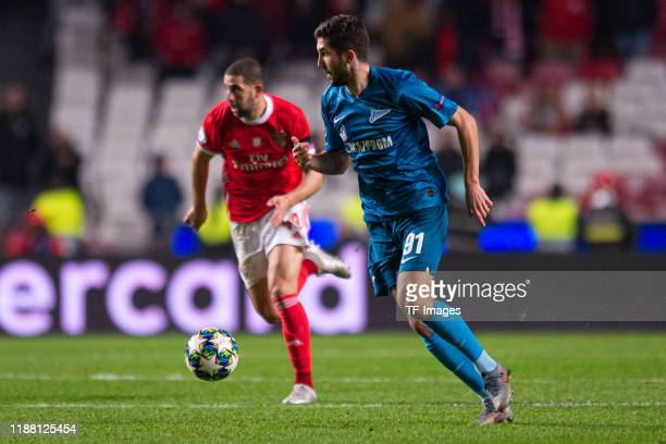 Adel Taarabt of SL Benfica and Aleksei Sutormin of Zenit St Petersburg battle for the ball during the UEFA Champions League group G match between SL...